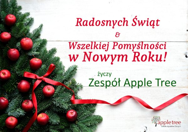 Red apples Christmas tree with red ribbon.white wooden background